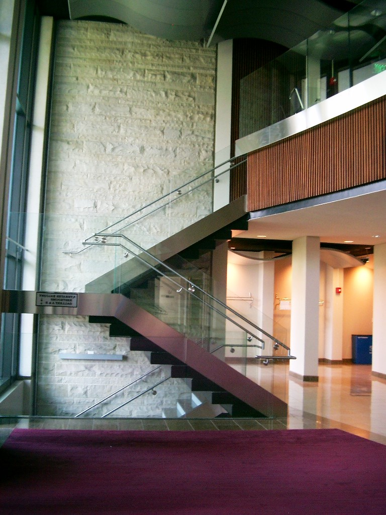 Glass and Stainless Steel Rails and Stainless Cladding